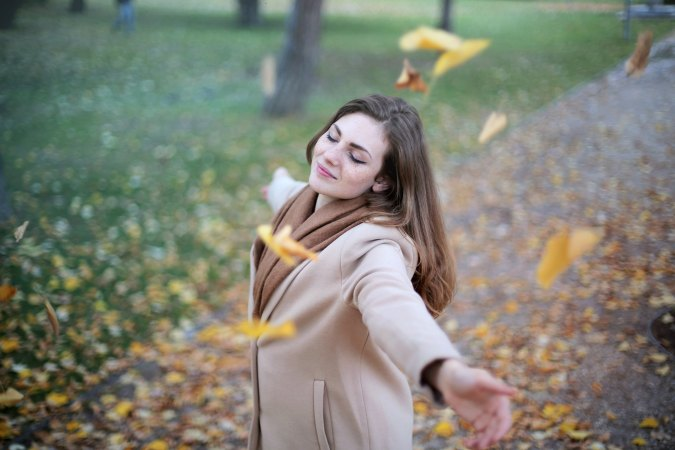 girl-dancing-in-fall-leaves