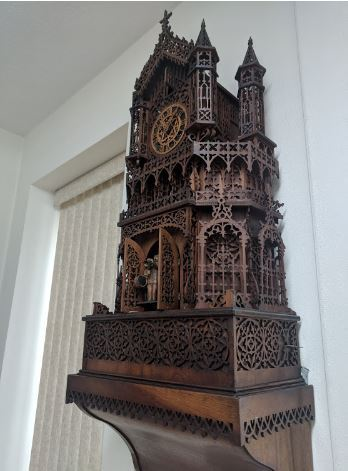 Wooden-carved-mechanical-clock