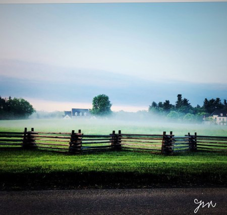 Mist at dawn house rail fence