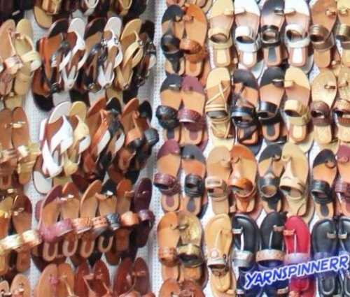 walls-of-mismatched-shoes-sandals-on-peg-board
