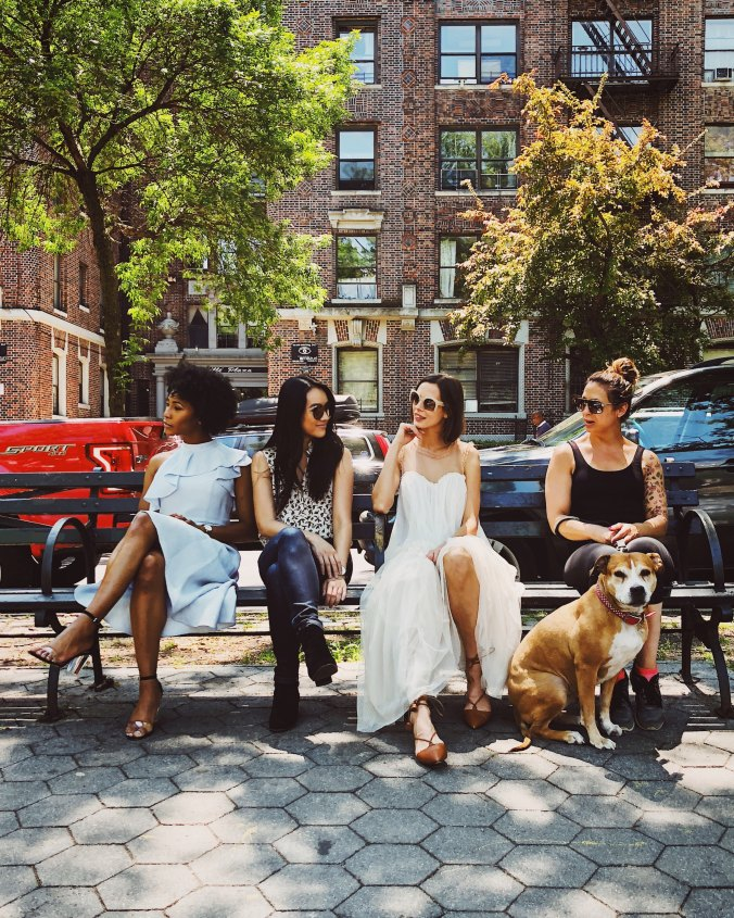 four-women-siting-on-a-NYC-park-bench