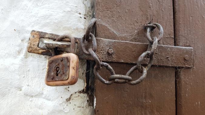 wood-door-metal-lock.