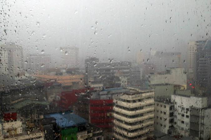 malaysia rain on window overlooking the city