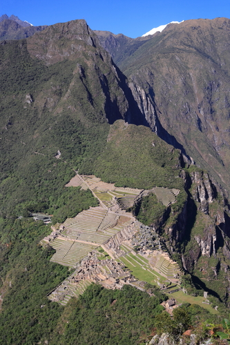 Rare and full view of ancient ruins of Machu Picchu in Peru from high above. Cloudless.