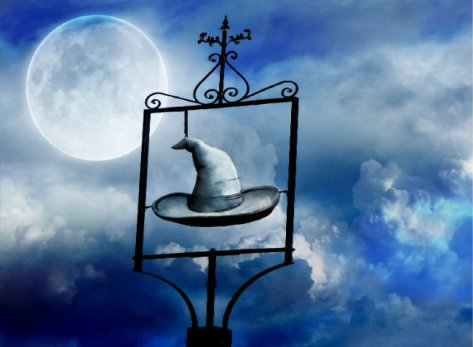 the image shows a clouded sky beneath a full moon. There is a wordless sign showing only a pointed hat, of the kind often worn by wizards