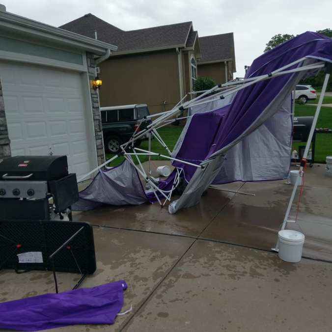 demolished-purple-tent on driveway with grills