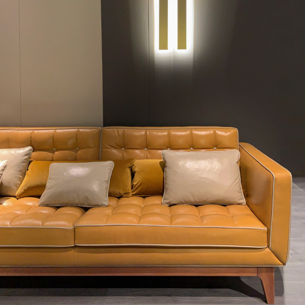 Photo by Francesca Tosolini on Unsplash   Yellow leather couch