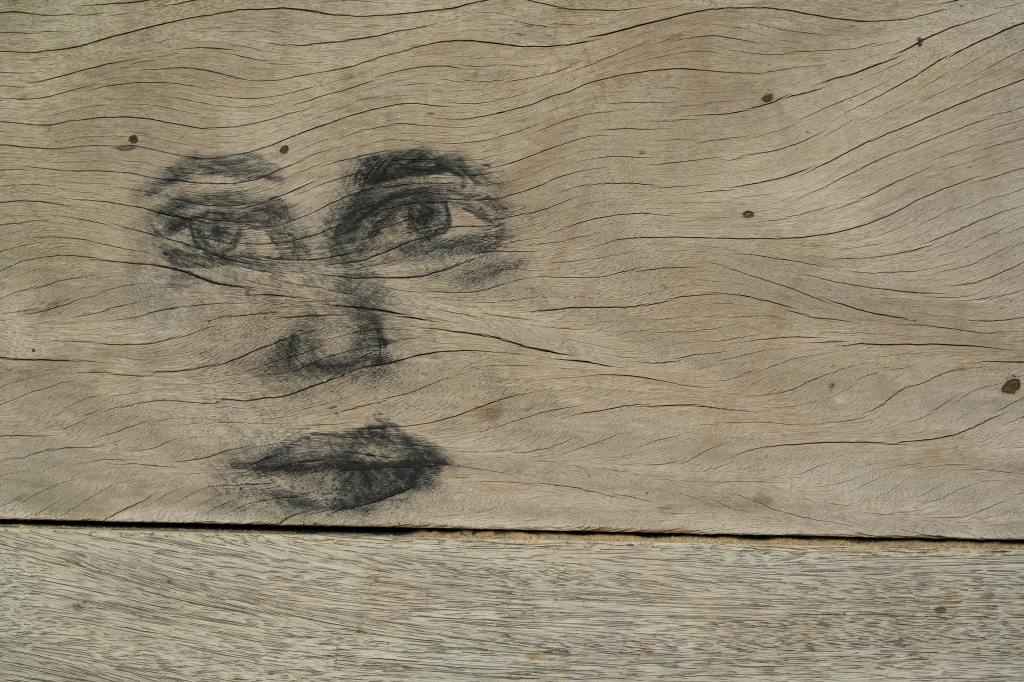 Outline of a woman's face on a wood board